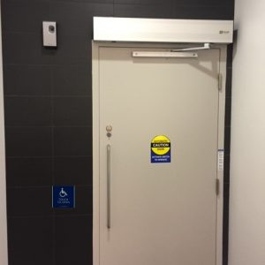 QUAD door handicap button