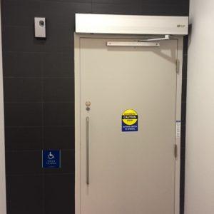 QUAD door handicap button